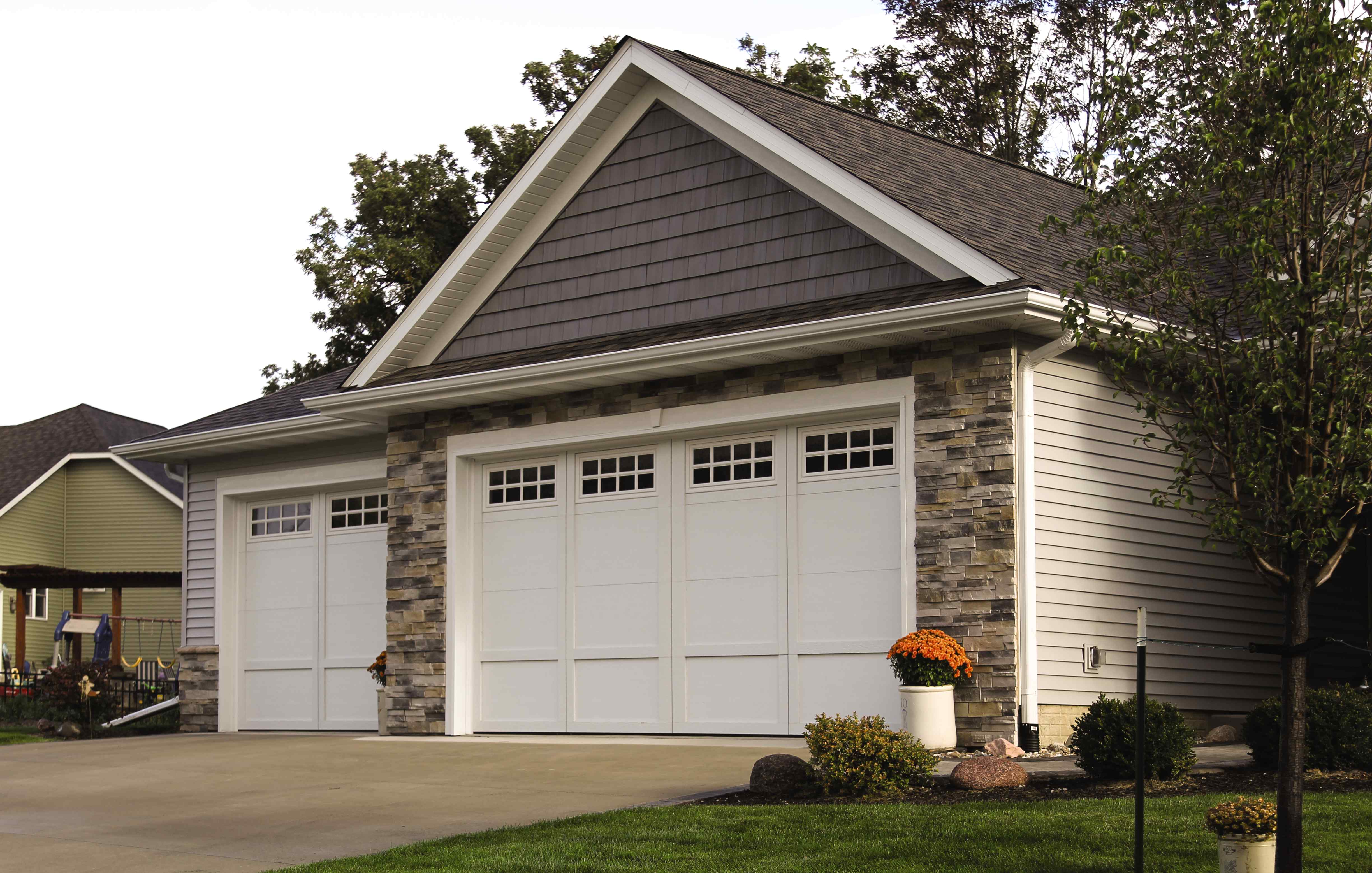 Courtyard Collection energy-efficient steel insulated garage doors - residential