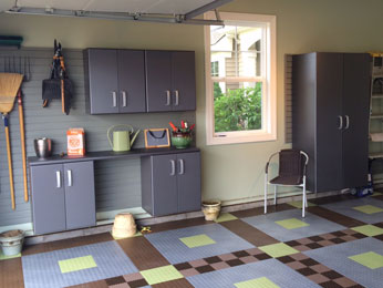 Garage storage cabinets and garage flooring create a hard-working and beautiful space.