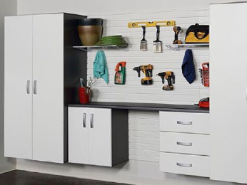 Easy access to your belongings in a neatly organized garage – utilize garage storage cabinets and a hook-based wall storage system.